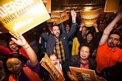 NDP supporters cheer after an NDP majority government is declared at the NDP election headquarters at the Westin Hotel in Edmonton, Alta. on Tuesday, May 5, 2015. Codie McLachlan/Edmonton Sun/Postmedia Network