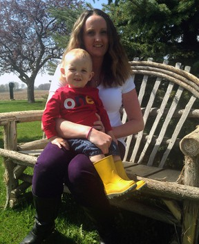 Lindsay Lackey and her 17-month-old son Benjamin enjoy the spring weather at their Shedden-area home. Benjamin has reflex anoxic seizures - a condition that causes him to lose consciousness with little warning. Lackey has started a support group for mothers of children with RAS.