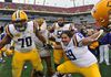 La'el Collins (left) and Fehoko Fanaika of the LSU Tigers celebrate after a win over the Iowa Hawkeyes January 1, 2014 in the Outback Bowl at Raymond James Stadium in Tampa. (Al Messerschmidt/Getty Images/AFP)