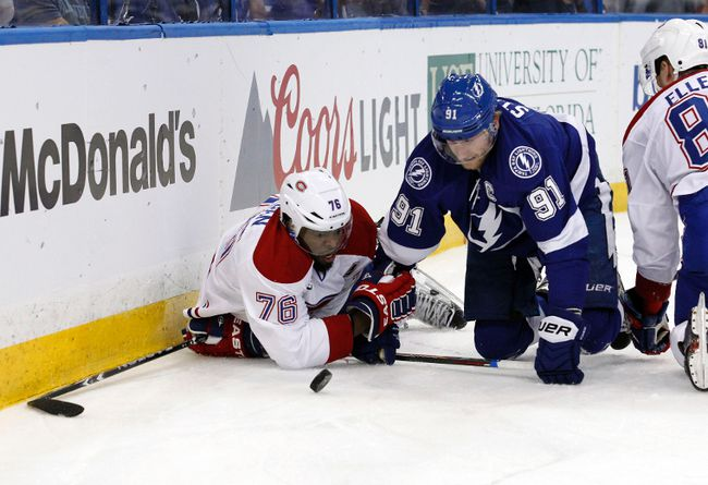 Montreal Canadiens defenceman P.K. Subban and Tampa Bay Lightning centre Steven Stamkos fight to control the puck during Game 4 Thursday at Amalie Arena. (Kim Klement/USA TODAY Sports)