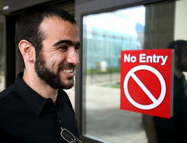 Omar Khadr smilies outside the Edmonton Law Courts Buildings on Thursday afternoon on May 7, 2015 after Alberta's highest court released the former Guantanamo Bay detainee on bail pending the appeal of his convictions in the United States. Tom Braid/Edmonton Sun/QMI Agency
