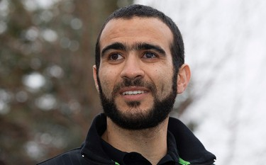 Omar Khadr speaks to the media outside his lawyer's west Edmonton home, where he will be staying after being granted parol, in Edmonton, Alta. on Thursday May 7, 2015. David Bloom/Edmonton Sun/Postmedia Network