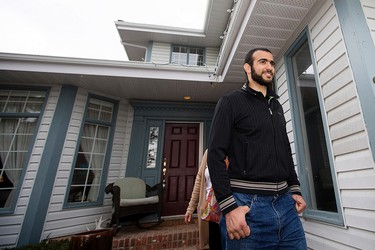 Omar Khadr walks out of his lawyer's west Edmonton home, where he will be staying after being granted parol, in Edmonton, Alta. on Thursday May 7, 2015. David Bloom/Edmonton Sun/Postmedia Network