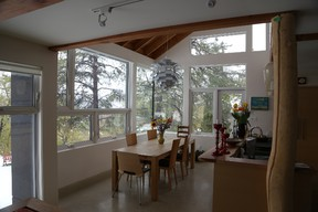 These giant windows in Jamie and Sharon Thompson's home in Boonie Doon help keep the house warm in the winter.