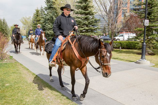 Master Cpl. Paul Nichols, a former Calgary Highlander, rides his horse Zoe along the Bow River Pathway in Calgary, Alta., on May 8, 2015. Nichols is riding across Canada to raise money and awareness of the issues facing Canada's war vets. (Lyle Aspinall/Postmedia Network)