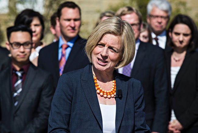 Premier-designate Rachel Notley addresses the media with her caucus behind her during the new NDP government's first caucus meeting at Government House in Edmonton, Alta. on Saturday, May 9, 2015. Codie McLachlan/Edmonton Sun/Postmedia Network