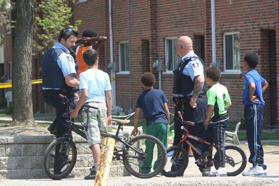 Toronto Community Housing special constables maintained a presence in the Danzig St. townhouse complex Saturday, May 10, 2015  after a woman was found slain the night before. CHRIS DOUCETTE/TORONTO SUN