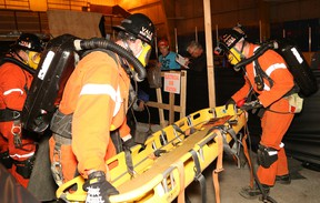 Team members from Vale West Mines compete in a mine rescue competition at the Jim Coady Memorial Arena in Levack on Friday. Winners of the competition move on to the annual Ontario Mine Rescue Provincial Competition, which takes place June 10-11 in Thunder Bay. (John Lappa/Sudbury Star)