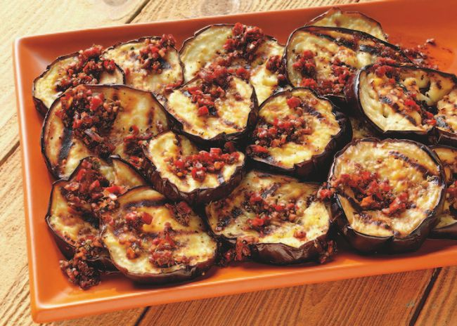 Globe Eggplant with Sun-Dried Tomato Vinaigrette recipe courtesy of Weber's New Real Grilling by Jamie Purviance.