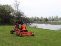 In this file photo, WRCC seasonal worker Ethan Mosley cuts the grass along the banks of the recreational canal. As the City of Welland takes over the WRCC, the question of how much it will cost to maintain the lands was recently raised at council.