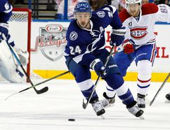 Tampa Bay Lightning right winger Ryan Callahan skates with the puck as Montreal Canadiens centre Lars Eller and defenceman P.K. Subban defend in Game 4 of the second round of the 2015 NHL playoffs at Amalie Arena on May 7, 2015. (Kim Klement/USA TODAY Sports)