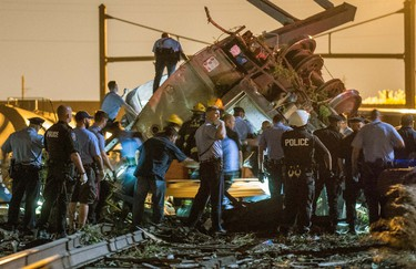 Emergency responders search for passengers following an Amtrak train derailment in the Frankfort section of  Philadelphia, Pennsylvania, May 12, 2015.  REUTERS/Bryan Woolston