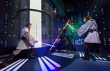 Wax figures of Star Wars characters Ben Kenobi, Darth Maul and Qui Gon Yin are pictured at the Star Wars At Madame Tussauds attraction in London on May 12, 2015. AFP PHOTO/JUSTIN TALLIS