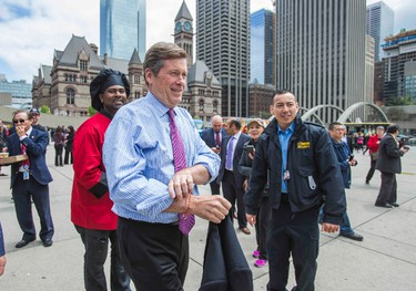 Toronto Mayor John Tory prepares to address the media as a part of Food Truck Freedom Day at Nathan Phillips Square in front of City Hall in Toronto, Ont.  on Wednesday May 13, 2015. Ernest Doroszuk/Toronto Sun
