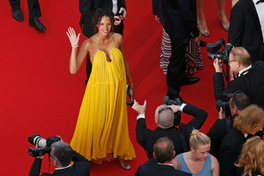 """Model Noemie Lenoir poses on the red carpet as she arrives for the opening ceremony and the screening of the film """"La tete haute"""" out of competition during the 68th Cannes Film Festival in Cannes, southern France, May 13, 2015. The 68th edition of the film festival will run from May 13 to May 24. REUTERS/Benoit Tessier"""