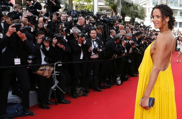 """Model Noemie Lenoir poses on the red carpet as she arrives for the opening ceremony and the screening of the film """"La tete haute"""" out of competition during the 68th Cannes Film Festival in Cannes, southern France, May 13, 2015. The 68th edition of the film festival will run from May 13 to May 24.  REUTERS/Regis Duvignau"""