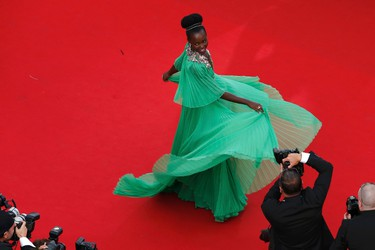 """Actress Lupita Nyong'o poses on the red carpet as she arrives for the opening ceremony and the screening of the film """"La tete haute"""" out of competition during the 68th Cannes Film Festival in Cannes, southern France, May 13, 2015. The 68th edition of the film festival will run from May 13 to May 24.  REUTERS/Benoit Tessier"""