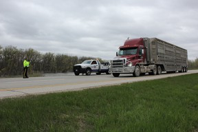 RCMP and CAA Manitoba staged a scene on the TransCanada Highway near St. Francois-Xavier May 13, 2015 where a tow truck was pulled over to the side with its lights on, set to assist a stalled vehicle. Of the 316 vehicles that drove by, almost 99% of drivers failed to slow down and move over as they passed the scene, an action punishable by a $300 fine and two demerits when enforced.