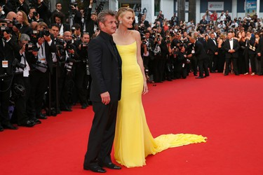 """Cast member Charlize Theron and actor Sean Penn pose on the red carpet as they arrive for the screening of the film """"Mad Max: Fury Road"""" out of competition at the 68th Cannes Film Festival in Cannes, southern France, May 14, 2015.  REUTERS/Benoit Tessier"""