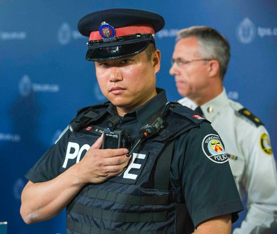 Toronto Police Service  Const. Ben Seto with a body-worn camera during the announcement of the  pilot project at police headquarters in Toronto, Ont.  on Friday May 15, 2015. The camera pictured is made by Reveal Media. Ernest Doroszuk/Toronto Sun