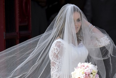 British singer and former member of the band Spice Girls Geri Halliwell arrives for her wedding with Formula One motor racing business owner Christian Horner at St. Mary's Church at Woburn in southern England May 15, 2015. REUTERS/Toby Melville