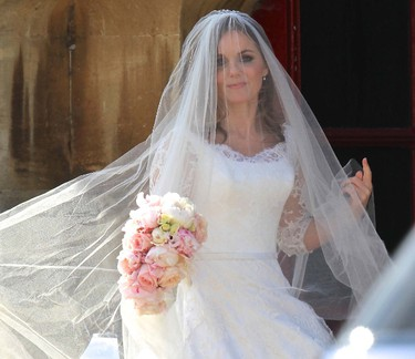 British singer and former member of the band Spice Girls Geri Halliwell arrives for her wedding with Formula One motor racing business owner Christian Horner at St. Mary's Church at Woburn in southern England May 15, 2015. (WENN.COM)