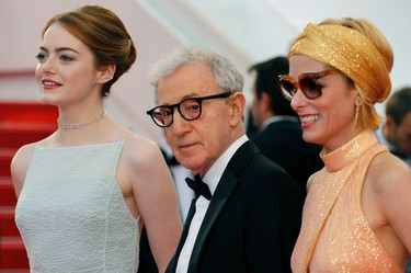 """Director Woody Allen (C), cast members Emma Stone (L) and Parker Posey pose on the red carpet as tey arrive for the screening of the film """"Irrational Man"""" out of competition at the 68th Cannes Film Festival in Cannes, southern France, May 15, 2015.  REUTERS/Regis Duvignau"""