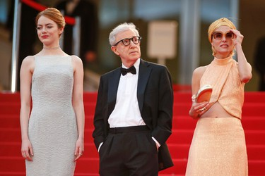 """Director Woody Allen (C), cast members Emma Stone (L) and Parker Posey pose on the red carpet as tey arrive for the screening of the film """"Irrational Man"""" out of competition at the 68th Cannes Film Festival in Cannes, southern France, May 15, 2015.  REUTERS/Benoit Tessier"""