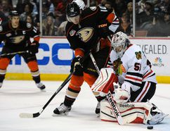 Chicago Blackhawks goalie Corey Crawford makes a save against Anaheim Ducks right winger Corey Perry during the second period at the Honda Center on Feb. 5, 2014. (Kelvin Kuo/USA TODAY Sports)