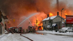 KIngston fire crews battle a massive fire at a construction site for student housing on Princess and Victoria streets in downtown Kingston on Dec. 17, 2013. (Ian MacAlpine/The Whig-Standard)