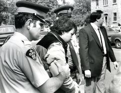 John Lee Jr. is escorted into court on June 5, 1986. (Ian MacAlpine/Whig-Standard file photo)