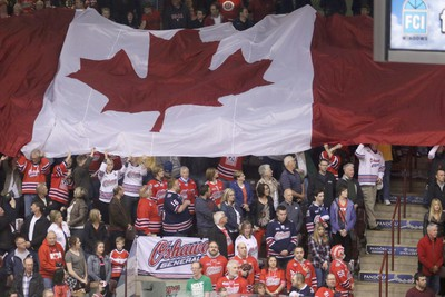 Fans show their patriotism before Game 5 of the OHL final between Oshawa Generals and Erie Otters at the CM Centre in Oshawa on May 15, 2015. (Pete Fisher/Postmedia Network)