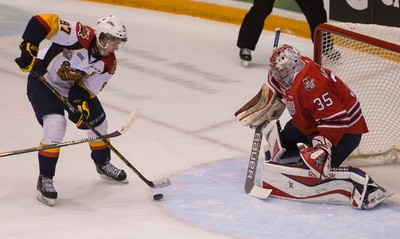 Oshawa Generals goaltender Kenny Appleby stops Erie Otters Connor McDavid in tight in Oshawa on Friday May 15, 2015. Craig Robertson/Toronto Sun/Postmedia Network