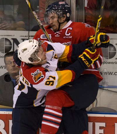 Oshawa Generals  Josh Brown gets hit by Erie Otters Connor McDavid. Oshawa Generals win the J. Ross Robertson Cup against the Erie Otters in Oshawa on Friday May 15, 2015. Craig Robertson/Toronto Sun/Postmedia Network