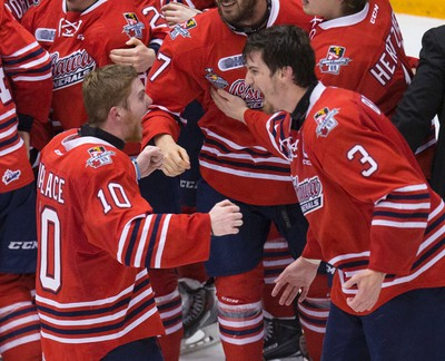 Oshawa Generals captain, Josh Brown and Aidan Wallace celebrate the win. Oshawa Generals  win the J. Ross Robertson Cup against the Erie Otters in Oshawa on Friday May 15, 2015. Craig Robertson/Toronto Sun/Postmedia Network