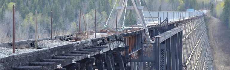 The burnt half of the Beaver River Trestle Bridge is seen on Tuesday May 12, 2015 in Cold Lake, Alta. Construction crews have started repairing and restoring the bridge to its original condition. Peter Lozinski/Cold Lake Sun/Postmedia Network