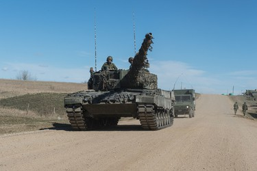 A Leopard 2A4 is driven down a road in the Wainwright training area during Exercise MAPLE RESOLVE. This training that runs from April 20 to May 23, 2015, at the Canadian Manoeuvre Training Centre in Wainwright, Alta., is a high-readiness exercise that involves close to 4,500 military personnel from Canada, the United States and the United Kingdom. Cpl True-dee McCarthy/DND Combat Camera
