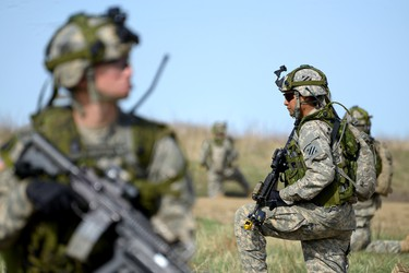 Soldiers from the United States - 3rd Infantry Division conduct a key leadership engagement in the mock village of Enriquillo in the Wainwright training area during Exercise MAPLE RESOLVE. This training that runs from April 20 to May 23, 2015, at the Canadian Manoeuvre Training Centre in Wainwright, Alta., is a high-readiness exercise that involves close to 4,500 military personnel from Canada, the United States and the United Kingdom. Sgt Dan Shouinard/DND Combat Camera
