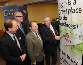 John Regan, left, general manager of the Elgin Business Resource Centre in St. Thomas, Alan Smith, general manager of economic development for Elgin County, Aylmer Mayor Jack Couckuyt and Elgin County Warden Bill Walters look over the county's location on this promotional banner on display at the new EBRC satellite office officially opened Friday March 2, 2012 in the Elgin Innovation Centre (formerly Imperial Tobacco offices on John Street) in Aylmer, Ontario in partnership with the county.
