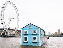 <b>Floating House, London:</b> This AirBnB house floats along London's River Thames and features a living room, two bedrooms, a bathroom and a garden. It glides past the London Eye, Houses of Parliament, Canary Wharf and Chelsea. (WENN.com)