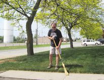Rick Descamps of Argyle Avenue in Delhi is disappointed with Norfolk County's plan to eliminate more than 40 locust and maple trees to make way for a sidewalk that will cramp his front yard and those of his neighbors. (MONTE SONNENBERG Simcoe Reformer)