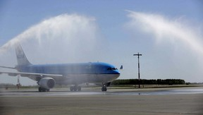 Water is sprayed over KLM Royal Dutch Airlines' first non-stop flight between Amsterdam Schiphol Airport after landing at the Edmonton International Airport (EIA).Photo Supplled/EIA