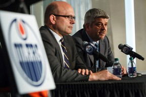 Edmonton Oilers new coach Todd McLellan (right) and general manager Peter Chiarelli are seen during a news conference announcing his hiring at the Fairmont Hotel MacDonald in Edmonton, Alta., on Tuesday May 19, 2015. Ian Kucerak/Edmonton Sun