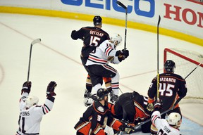 Chicago Blackhawks center Marcus Kruger (16) celebrates after scoring the game-winning goal against the Anaheim Ducks in the third overtime period in game two of the Western Conference Final of the 2015 Stanley Cup Playoffs at Honda Center. Mandatory Credit: Gary Vasquez-USA TODAY Sports
