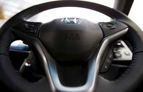 An airbag logo is seen on a steering wheel of Honda Motor Co's all-new hybrid sedan Grace, in which an airbag made by Takata Corp has been installed, during its unveiling event in Tokyo, in this December 1, 2014 file photo. (REUTERS/Toru Hanai/Files)
