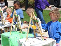 Brynnae Willsey, Zakaiah Turyamwijuka, Paul Munro, and Zoe Rudolph work on their paintings of the Trinity United Church on May 15, 2015. Artist Lee Beaton has been working with the Portage Ukrainian Nursery School students for several months before they were able to go across the street from the church and set up eisles to finish their paintings. Beaton was teaching the students through an ArtsSmarts grant the school had received. (Johnna Ruocco/THE GRAPHIC/POSTMEDIA NETWORK)