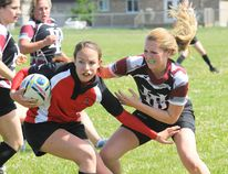 Waterford's Danielle Hiltz tries to shake Holy Trinity defender Rachel Feeney during the Zeldon Cup on Wednesday in Simcoe. The Titans won the match 12-0 to claim their third straight Norfolk title. (JACOB ROBINSON Simcoe Reformer)