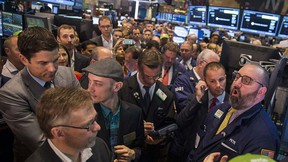 Shopify founder and chief executive officer Tobi Lutke (2nd L, with hat) waits for the company's IPO on the floor of the New York Stock Exchange May 21, 2015.  REUTERS/Lucas Jackson