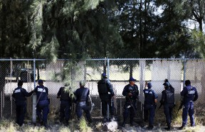 Federal policemen guard a ranch where a gunfight between hitmen and federal forces left several casualties in Tanhuato, state of Michoacan, May 22, 2015. (ALAN ORTEGA/Reuters)