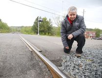 In this file photo, Jeff Walker, a professor in the School of Engineering at Cambrian College,examines a railway track in Sudbury. Gino Donato/Sudbury